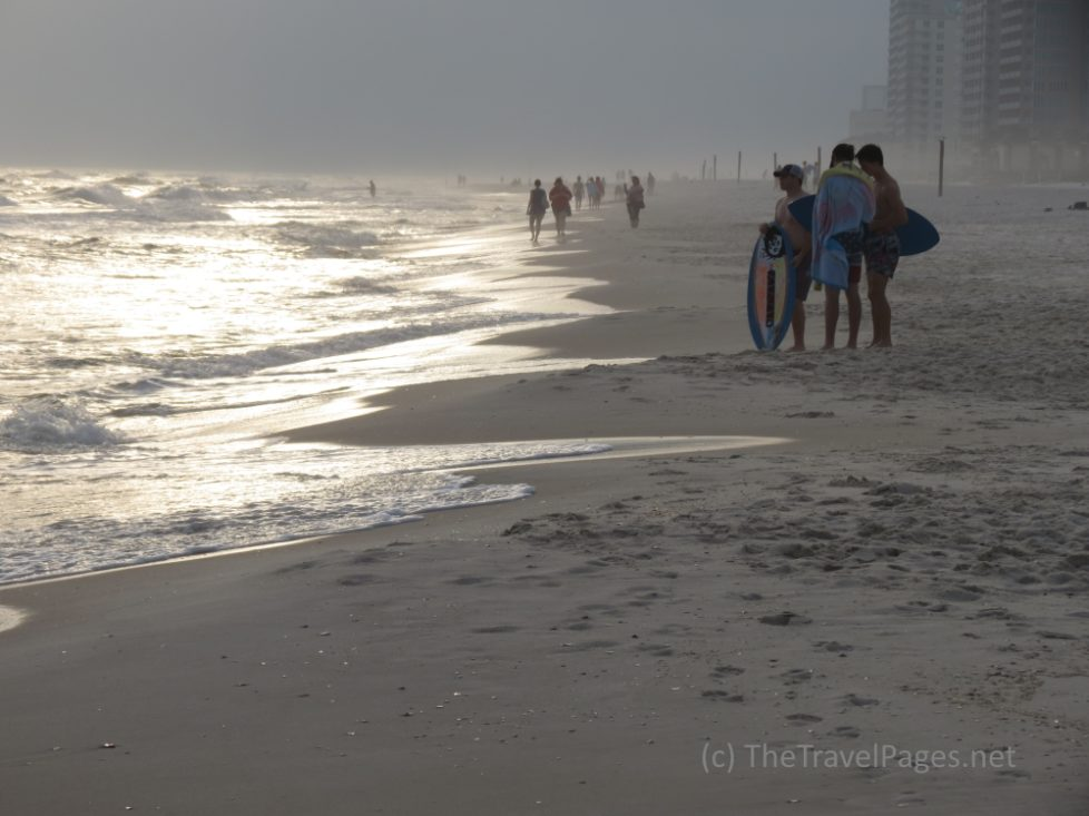 Surfers at sunset in Gulf Shores, Alabama