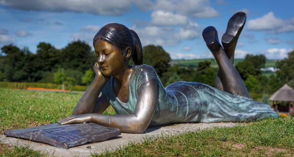 Bronze statue of a girl reading in Cork, Ireland